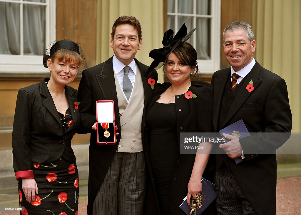 Actor Sir <a gi-track='captionPersonalityLinkClicked' href=/galleries/search?phrase=Kenneth+Branagh&family=editorial&specificpeople=213618 ng-click='$event.stopPropagation()'>Kenneth Branagh</a> poses with his award alongside his wife Lindsay (second right), his brother Bill (R) and sister Joyce (L) after receiving a knighthood from Queen Elizabeth II at an investiture ceremony at Buckingham Palace on November 9, 2012 in London, England.