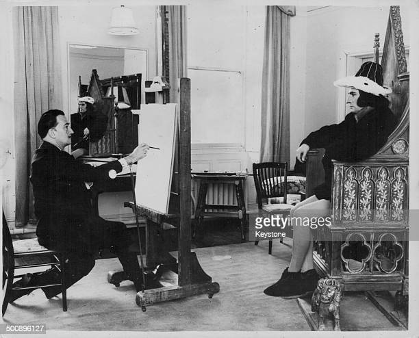 Actor Sir Laurence Olivier in costume as Richard III sitting for a portrait with artist Salvador Dali at Shepperton Studios London April 10th 1956