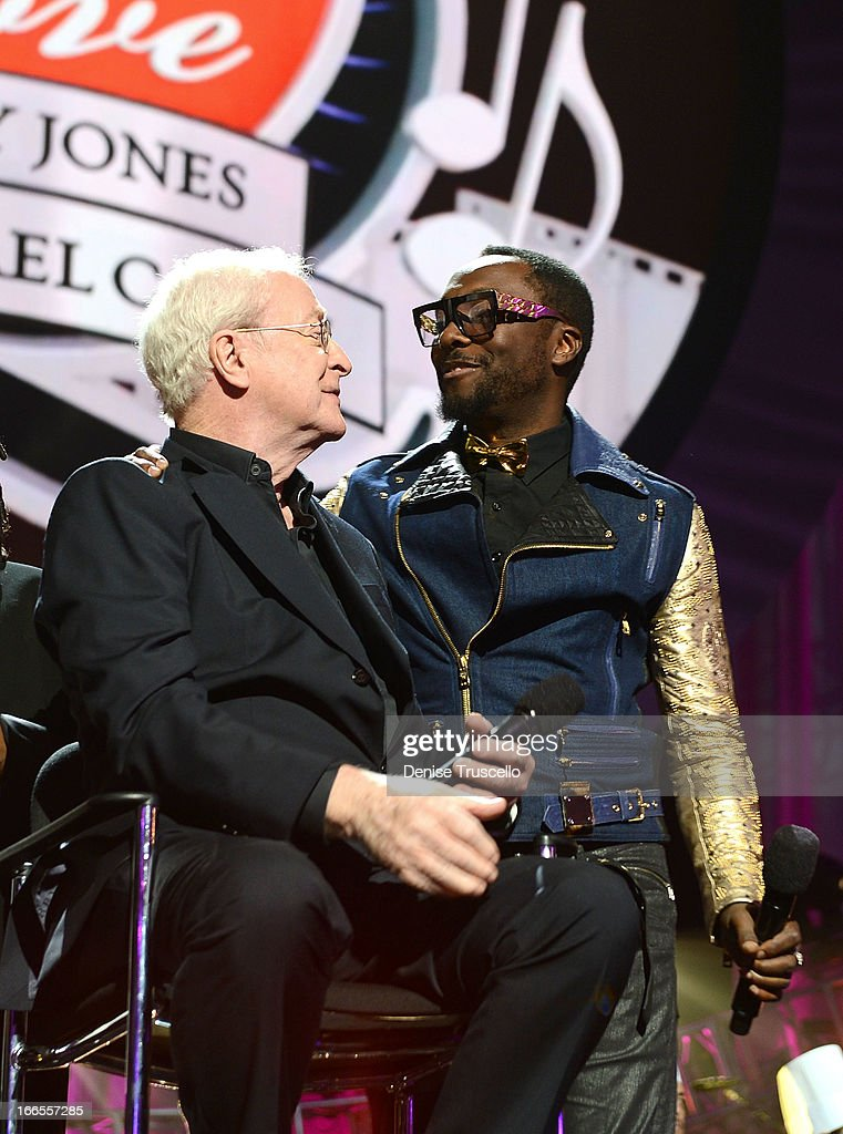 Actor Sir Michael Caine and recording artist will.i.am speak onstage during the 17th annual Keep Memory Alive 'Power of Love Gala' benefit for the Cleveland Clinic Lou Ruvo Center for Brain Health celebrating the 80th birthdays of Quincy Jones and Sir Michael Caine on April 13, 2013 in Las Vegas, Nevada.