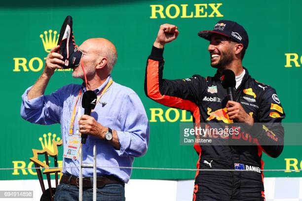 Actor Sir Patrick Stewart celebrates on the podium with Daniel Ricciardo of Australia and Red Bull Racing and a shoey during the Canadian Formula One...