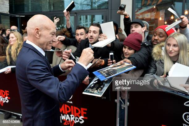 Actor Sir Patrick Stewart signs autographs at the THREE Empire awards at The Roundhouse on March 19 2017 in London England