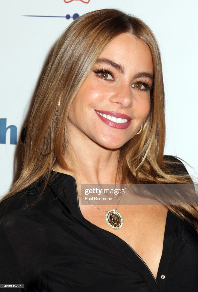 Actor Sofía Vergara arrives at 'Tie The Knot' Store Grand Opening with founder Jesse Tyler Ferguson at The Beverly Center on December 5, 2013 in Los Angeles, California.