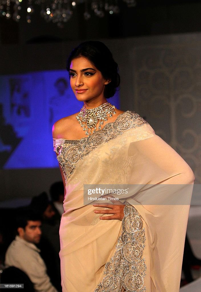 Actor Sonam Kapoor showcasing diamond jewellery during the an event of announcing of India's first Gem and Jewellery Fair, on February 12, 2013 in New Delhi, India. Organized by Gems and Jewellery Export Promotion Council the India Gems Jewellery Fair will start from April 6.