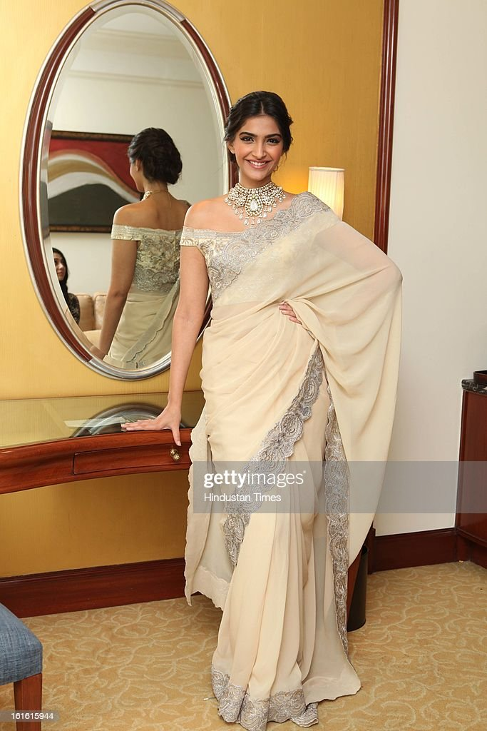 Actor Sonam Kapoor showcasing diamond jewellery during the event of announcing of India's first Gem and Jewellery Fair, on February 12, 2013 in New Delhi, India. Organized by Gems and Jewellery Export Promotion Council the India Gems Jewellery Fair will start from April 6.