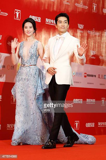 Actor Song Seungheon and actress Liu Yifei arrive at the red carpet of ISIFF Gala Night during the 18th Shanghai International Film Festival at...