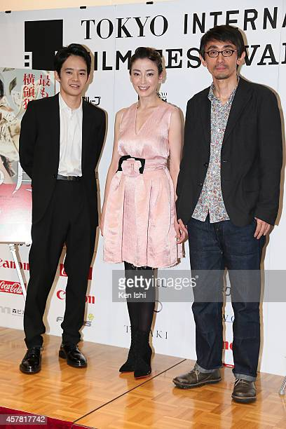 Actor Sosuke Ikematsu actress Rie Miyazawa and director Daihachi Yoshida attend the press conference for 'Pale Moon' premiere during the 27th Tokyo...