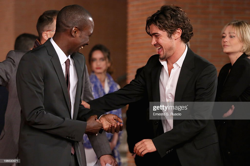 Actor Souleymane Sow and <a gi-track='captionPersonalityLinkClicked' href=/galleries/search?phrase=Riccardo+Scamarcio&family=editorial&specificpeople=816804 ng-click='$event.stopPropagation()'>Riccardo Scamarcio</a> attend the 'Cosimo E Nicole' Premiere during the 7th Rome Film Festival at Auditorium Parco Della Musica on November 16, 2012 in Rome, Italy.