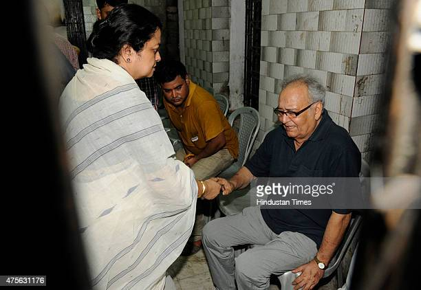 Actor Soumitra Chattopadhyay and daughterinlaw Lalita mourn after the death of Bijoya Ray widow of filmmaker Satyajit Ray on June 2 2015 in Kolkata...
