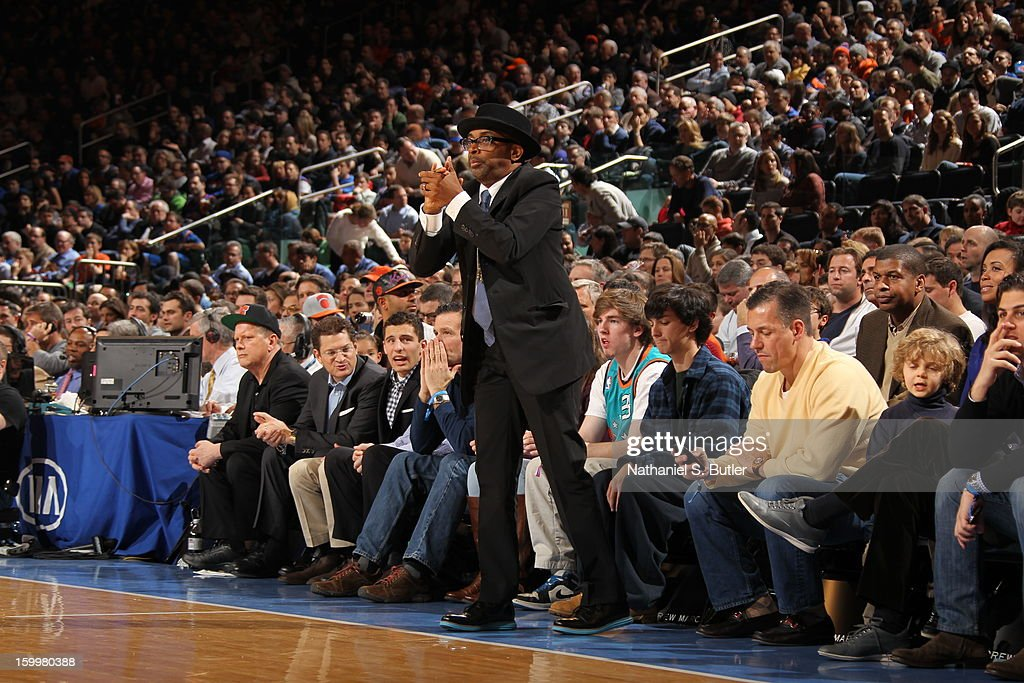 Actor, <a gi-track='captionPersonalityLinkClicked' href=/galleries/search?phrase=Spike+Lee&family=editorial&specificpeople=156419 ng-click='$event.stopPropagation()'>Spike Lee</a> cheers on the New York Knicks as they play against the Brooklyn Nets on January 21, 2013 at Madison Square Garden in New York City.