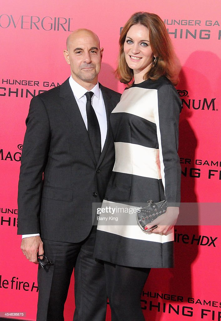 Actor <a gi-track='captionPersonalityLinkClicked' href=/galleries/search?phrase=Stanley+Tucci&family=editorial&specificpeople=209366 ng-click='$event.stopPropagation()'>Stanley Tucci</a> (L) and his wife/literary agent <a gi-track='captionPersonalityLinkClicked' href=/galleries/search?phrase=Felicity+Blunt&family=editorial&specificpeople=2352501 ng-click='$event.stopPropagation()'>Felicity Blunt</a> arrive at the Los Angeles Premiere 'The Hunger Games: Catching Fire' on November 18, 2013 at Nokia Theatre L.A. Live in Los Angeles, California.