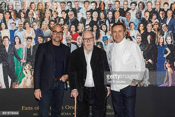 Actor Stanley Tucci artist Sir Peter Blake and Chef Daniel Boulud pose for a photo as a new artwork 'Our Fans' by Sir Peter Blake is unveiled on...