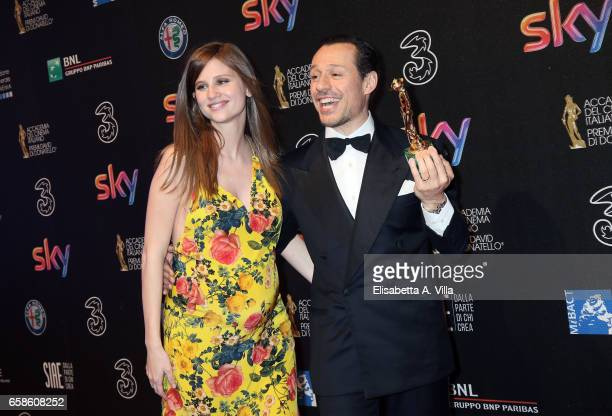 Actor Stefano Accorsi and wife Bianca Vitali pose with his Best Actor Award at the end of the 61 David Di Donatello ceremony on March 27 2017 in Rome...
