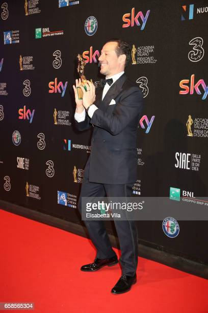 Actor Stefano Accorsi poses with his Best Actor Award during the 61 David Di Donatello ceremony on March 27 2017 in Rome Italy