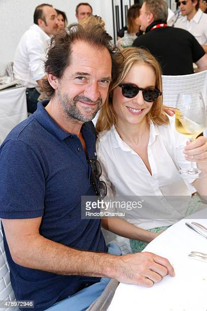 Actor Stephane De Groodt and his wife Odile d'Oultremont attend the 2015 Roland Garros French Tennis Open Day Thirteen on June 5 2015 in Paris France