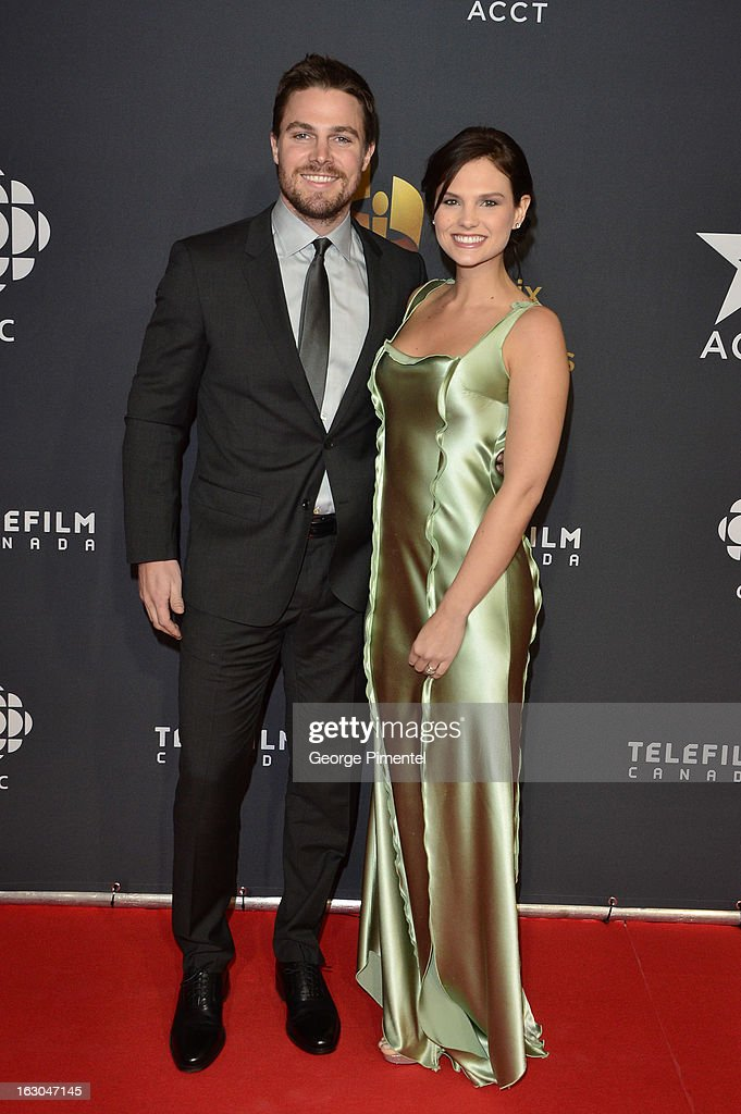 Actor <a gi-track='captionPersonalityLinkClicked' href=/galleries/search?phrase=Stephen+Amell&family=editorial&specificpeople=4500297 ng-click='$event.stopPropagation()'>Stephen Amell</a> and Cassandra Jean arrive at the Canadian Screen Awards at the Sony Centre for the Performing Arts on March 3, 2013 in Toronto, Canada.