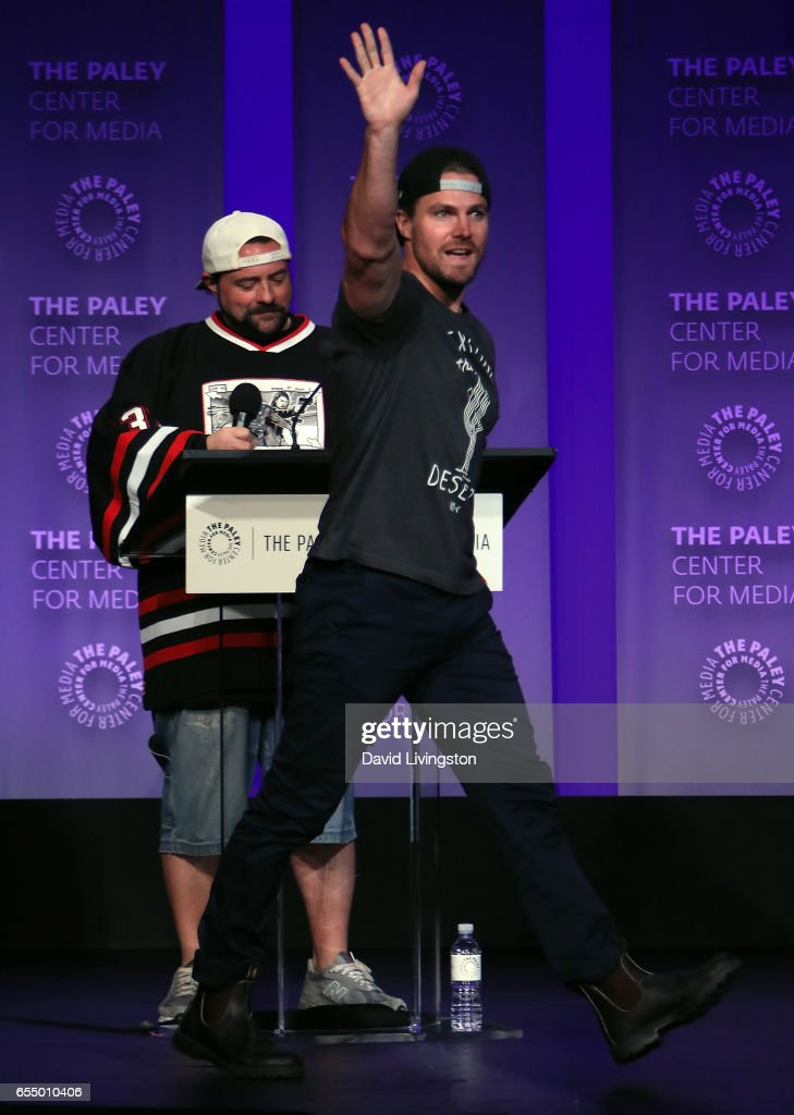 Actor Stephen Amell (R) and director moderator Kevin Smith appear on stage at The Paley Center for Media's 34th Annual PaleyFest Los Angeles presentation of The CW's Heroes & Aliens at Dolby Theatre on March 18, 2017 in Hollywood, California.