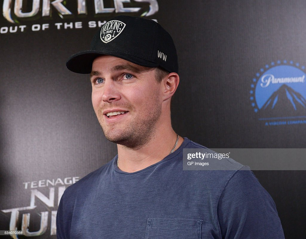Actor <a gi-track='captionPersonalityLinkClicked' href=/galleries/search?phrase=Stephen+Amell&family=editorial&specificpeople=4500297 ng-click='$event.stopPropagation()'>Stephen Amell</a> attends a special screening of 'Teenage Mutant Ninja Turtles: Out Of The Shadows' at Scotiabank Theatre on May 24, 2016 in Toronto, Canada.