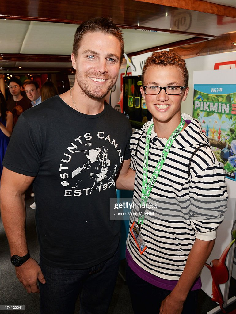 Actor <a gi-track='captionPersonalityLinkClicked' href=/galleries/search?phrase=Stephen+Amell&family=editorial&specificpeople=4500297 ng-click='$event.stopPropagation()'>Stephen Amell</a> (L) attends the Nintendo Oasis on the TV Guide Magazine Yacht at Comic-Con day 3 on July 20, 2013 in San Diego, California.
