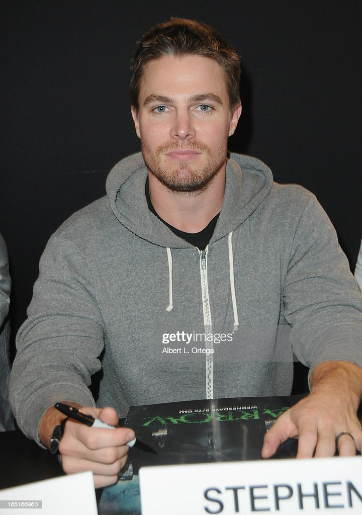 Actor Stephen Amell of The WB's 'Arrow' signs autographs at the DC Comics booth at WonderCon Anaheim 2013 - Day 3 held at Anaheim Convention Center on March 31, 2013 in Anaheim, California.