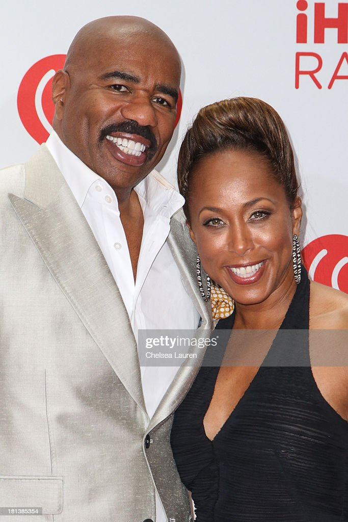 Actor <a gi-track='captionPersonalityLinkClicked' href=/galleries/search?phrase=Steve+Harvey&family=editorial&specificpeople=210865 ng-click='$event.stopPropagation()'>Steve Harvey</a> (L) and wife Marjorie Harvey pose in the iHeartRadio music festival photo room on September 20, 2013 in Las Vegas, Nevada.
