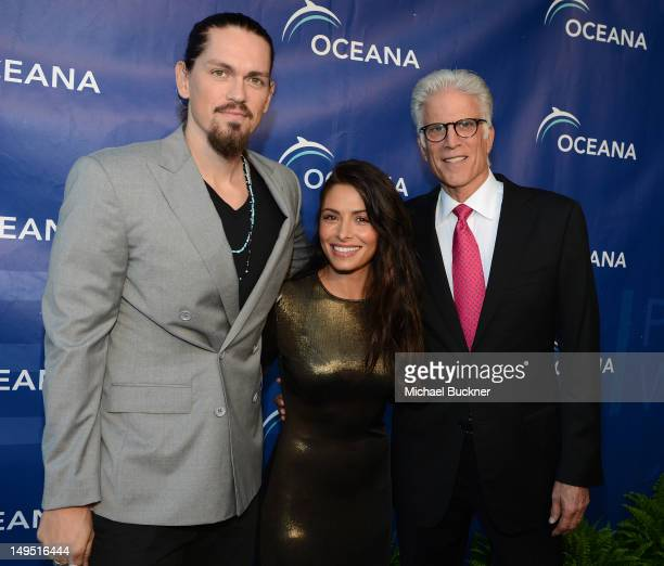 Actor Steve Howey actress Sarah Shahi and actor Ted Danson arrive at the 2012 Oceana's SeaChange Party at a private residence on July 29 2012 in...