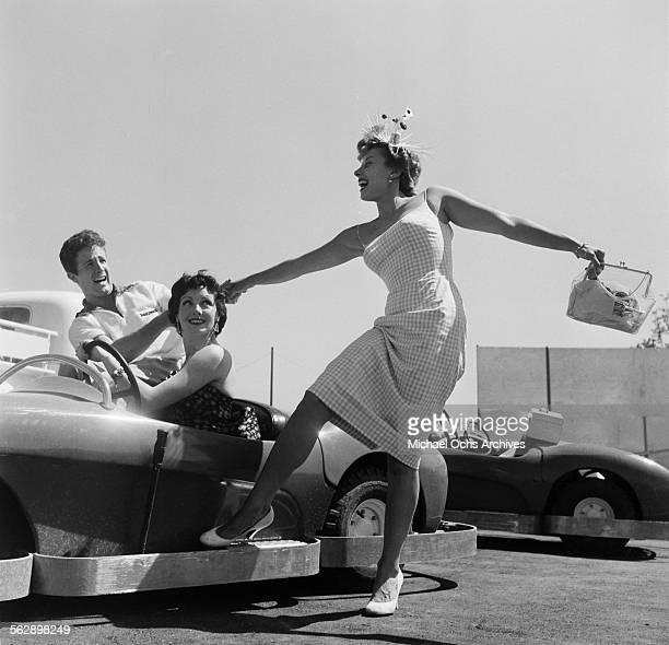 Actor Steve Rowland and actress Kathleen Case and Adelle August pose as they ride on Autopia during the Opening day of Disneyland in AnaheimCalifornia