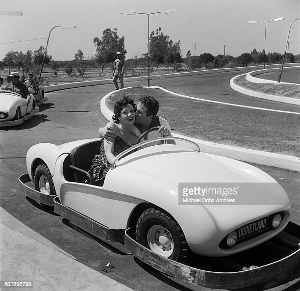 Actor Steve Rowland and actress Kathleen Case pose as they ride on Autopia during the Opening day of Disneyland in AnaheimCalifornia