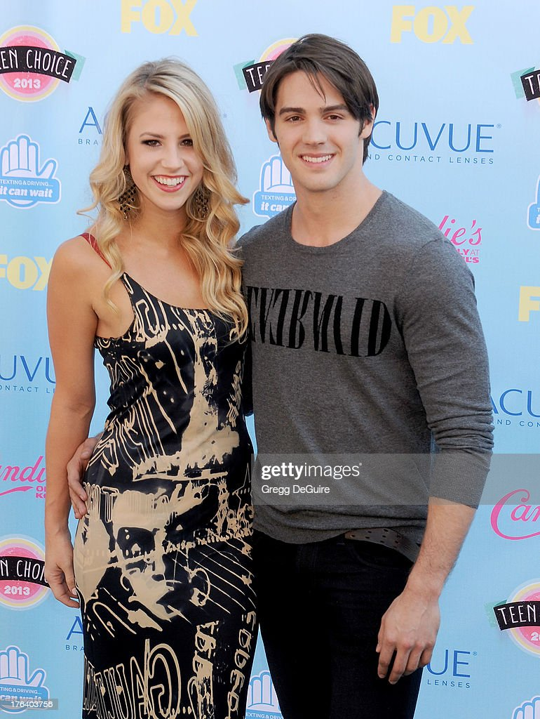 Actor Steven R. McQueen and guest arrive at the 2013 Teen Choice Awards at Gibson Amphitheatre on August 11, 2013 in Universal City, California.