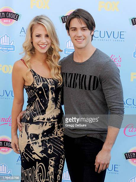 Actor Steven R McQueen and guest arrive at the 2013 Teen Choice Awards at Gibson Amphitheatre on August 11 2013 in Universal City California