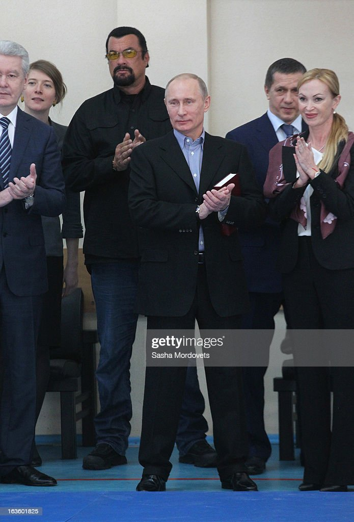 U.S. actor <a gi-track='captionPersonalityLinkClicked' href=/galleries/search?phrase=Steven+Seagal&family=editorial&specificpeople=220891 ng-click='$event.stopPropagation()'>Steven Seagal</a> and Russian President <a gi-track='captionPersonalityLinkClicked' href=/galleries/search?phrase=Vladimir+Putin&family=editorial&specificpeople=154896 ng-click='$event.stopPropagation()'>Vladimir Putin</a> are seen visiting Sambo-70, a Russian martial art and combat sport school, March 13, 2013 in Moscow, Russia.