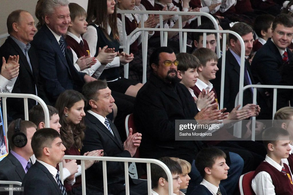 U.S. actor <a gi-track='captionPersonalityLinkClicked' href=/galleries/search?phrase=Steven+Seagal&family=editorial&specificpeople=220891 ng-click='$event.stopPropagation()'>Steven Seagal</a> (C) and Russian President <a gi-track='captionPersonalityLinkClicked' href=/galleries/search?phrase=Vladimir+Putin&family=editorial&specificpeople=154896 ng-click='$event.stopPropagation()'>Vladimir Putin</a> (top L) visit Sambo-70, a Russian martial art and combat sport school, March 13, 2013 in Moscow, Russia. Seagal and Putin were the guests of honor at the opening of the center.