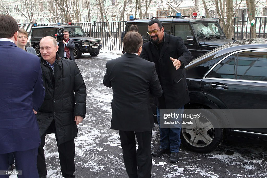 U.S. actor <a gi-track='captionPersonalityLinkClicked' href=/galleries/search?phrase=Steven+Seagal&family=editorial&specificpeople=220891 ng-click='$event.stopPropagation()'>Steven Seagal</a> (R) and Russian President <a gi-track='captionPersonalityLinkClicked' href=/galleries/search?phrase=Vladimir+Putin&family=editorial&specificpeople=154896 ng-click='$event.stopPropagation()'>Vladimir Putin</a> (L) visit Sambo-70, a Russian martial art and combat sport school, March 13, 2013 in Moscow, Russia. Seagal and Putin were the guests of honor at the opening of the center.