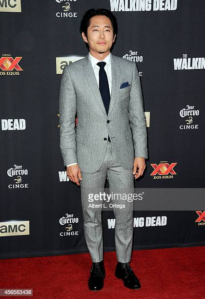 Actor Steven Yeun arrives for the Season 5 Premiere Of 'The Walking Dead' held at AMC Universal City Walk on October 2 2014 in Universal City...