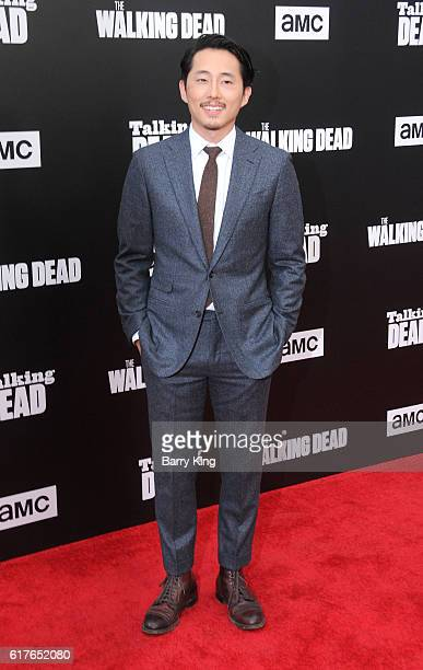 Actor Steven Yeun attends AMC Presents Live 90Minute Special Edition of 'Talking Dead' at Hollywood Forever on October 23 2016 in Hollywood California