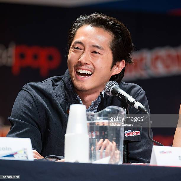 Actor Steven Yeun attends AMC's 'The Walking Dead' panel at 2014 New York Comic Con Day 3 at Jacob Javitz Center on October 11 2014 in New York City
