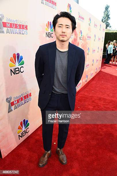 Actor Steven Yeun attends the 2015 iHeartRadio Music Awards which broadcasted live on NBC from The Shrine Auditorium on March 29 2015 in Los Angeles...