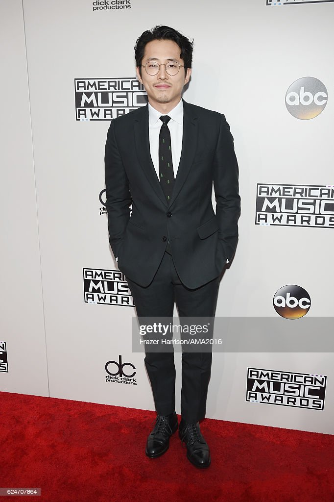 Actor Steven Yeun attends the 2016 American Music Awards at Microsoft Theater on November 20, 2016 in Los Angeles, California.