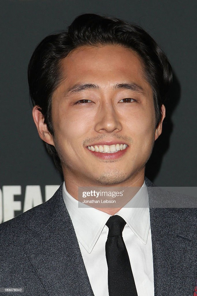 Actor <a gi-track='captionPersonalityLinkClicked' href=/galleries/search?phrase=Steven+Yeun&family=editorial&specificpeople=7249223 ng-click='$event.stopPropagation()'>Steven Yeun</a> attends the AMC's 'The Walking Dead' - Season 4 Premiere Party at AMC Universal City Walk on October 3, 2013 in Universal City, California.