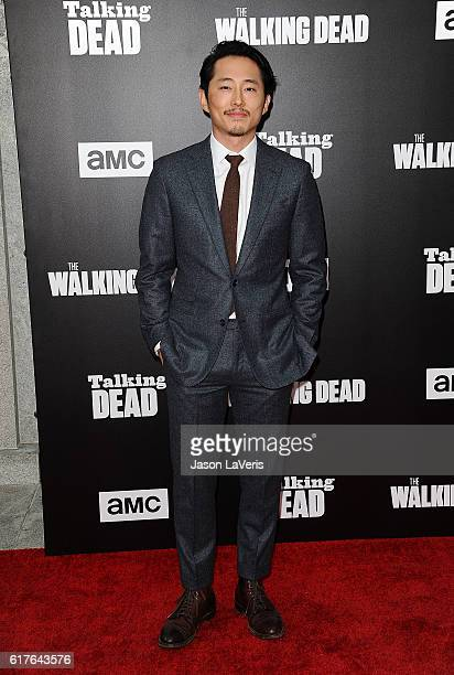 Actor Steven Yeun attends the live 90minute special edition of 'Talking Dead' at Hollywood Forever on October 23 2016 in Hollywood California