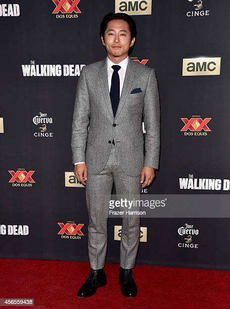 Actor Steven Yeun attends the season 5 premiere of 'The Walking Dead' at AMC Universal City Walk on October 2 2014 in Universal City California