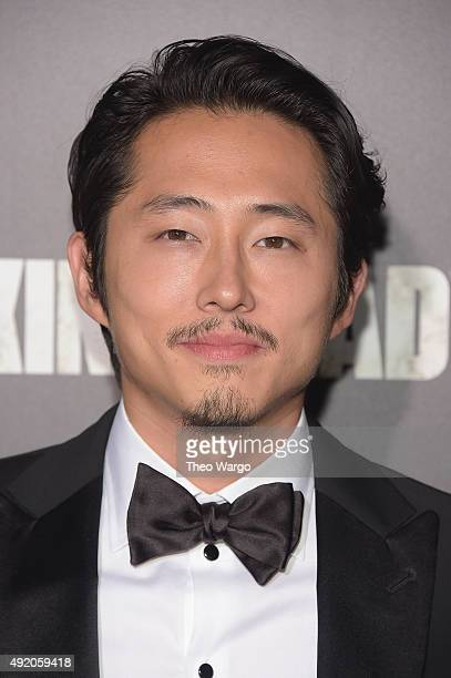 Actor Steven Yeun attends the season six premiere of 'The Walking Dead' at Madison Square Garden on October 9 2015 in New York City