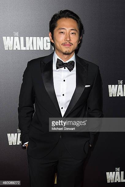 Actor Steven Yeun attends 'The Walking Dead' season six premiere at Madison Square Garden on October 9 2015 in New York City