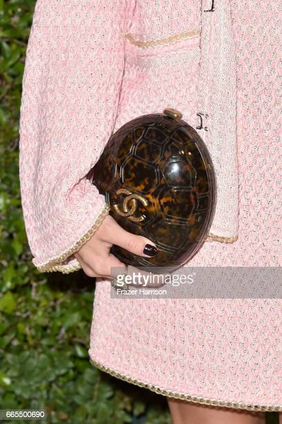Actor Stormi Henley handbag detail attends the celebration of Chanel's Gabrielle Bag hosted by Caroline De Maigret and Pharrell Williams at Giorgio...