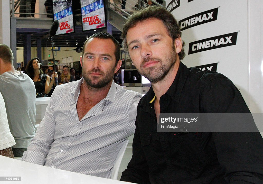 Actor Sullivan Stapleton (L) and director Michael J. Bassett attend Cinemax's 'Strike Back' cast autograph signing at San Diego Convention Center on July 19, 2013 in San Diego, California.