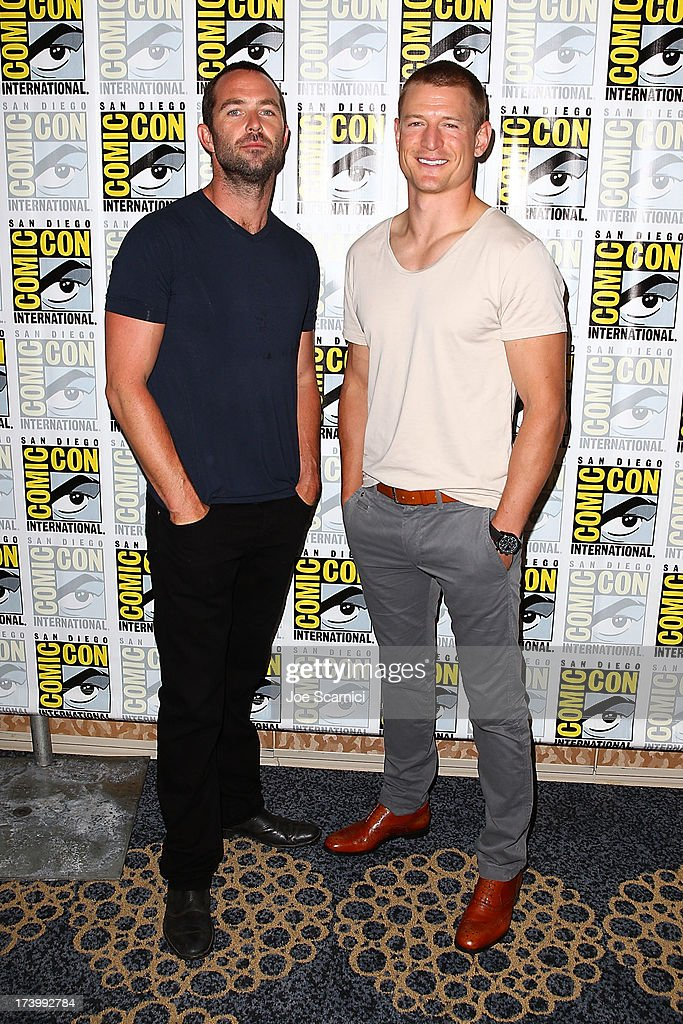 Actor Sullivan Stapleton and Phillip Winchester attend the Strike back press line at Comic-Con International 2013 - Day 1 on July 18, 2013 in San Diego, California.