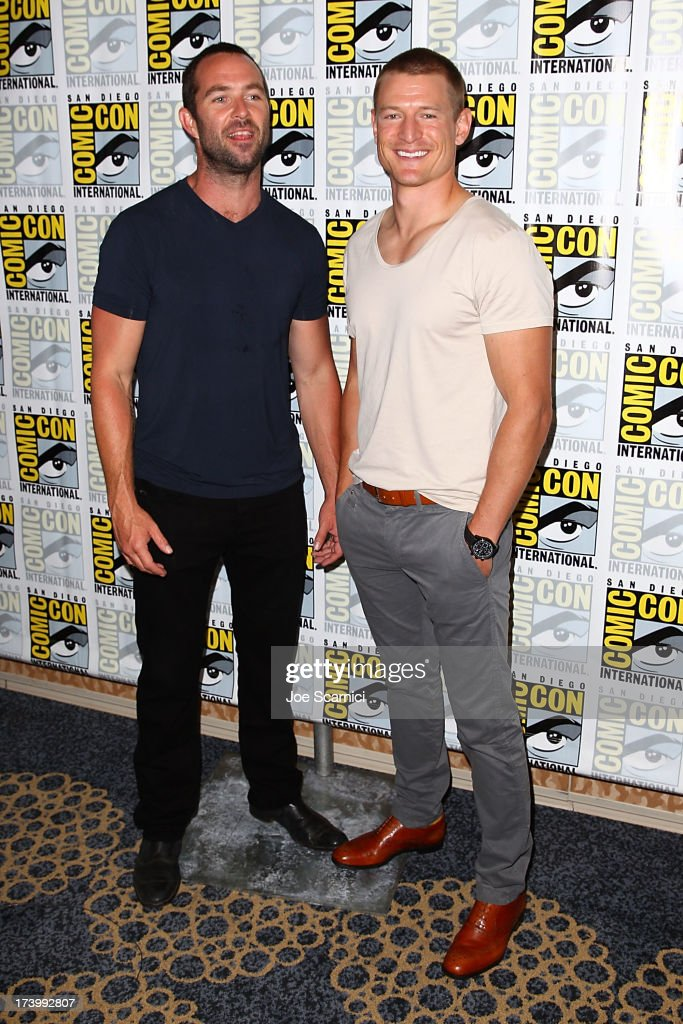 Actor Sullivan Stapleton and Phillip Winchester (R) attend the Strike back press line at Comic-Con International 2013 - Day 1 on July 18, 2013 in San Diego, California.