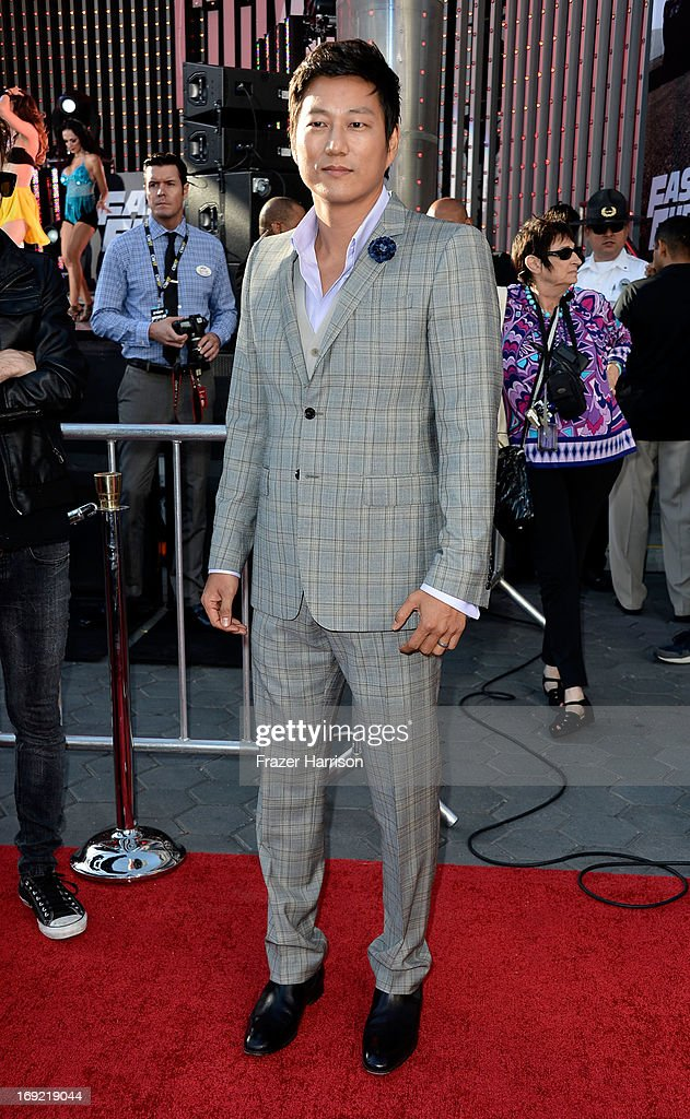 Actor <a gi-track='captionPersonalityLinkClicked' href=/galleries/search?phrase=Sung+Kang+-+Actor&family=editorial&specificpeople=2582012 ng-click='$event.stopPropagation()'>Sung Kang</a> arrives at the Premiere Of Universal Pictures' 'Fast & Furious 6' on May 21, 2013 in Universal City, California.