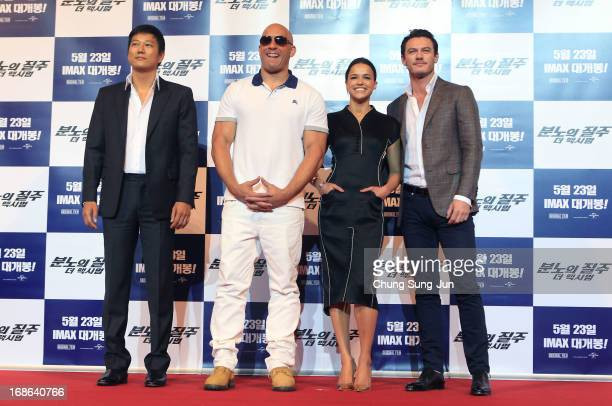 Actor Sung Kang Vin diesel actress Michelle Rodriguez and actor Luke Evans attend the 'Fast Furious 6' press conference on May 13 2013 in Seoul South...