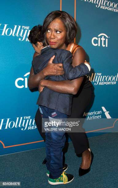 Actor Sunny Pawar is embraced by actress Viola Davis during the Hollywood Reporter's 5th Annual Nominees Night on February 6 2017 in Beverly Hills...