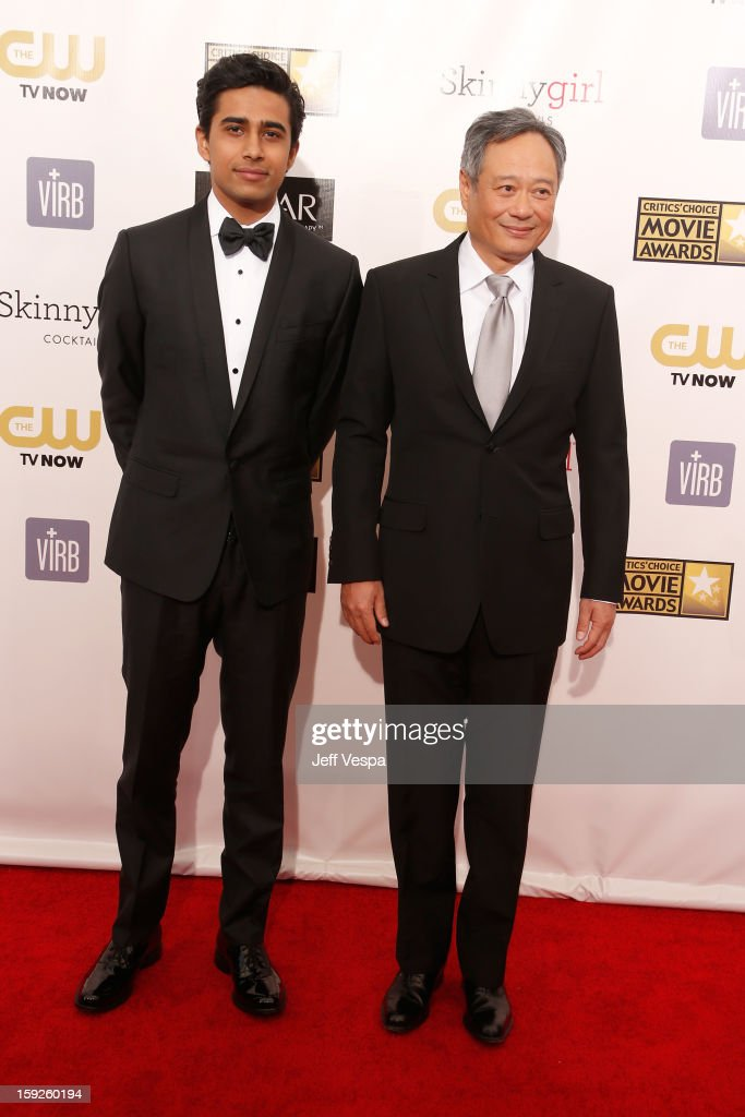 Actor Suraj Sharma and director Ang Lee arrive at the 18th Annual Critics' Choice Movie Awards at The Barker Hangar on January 10, 2013 in Santa Monica, California.